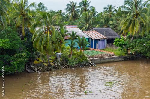 Papel de parede Riverside stilt houses in the Mekong Delta