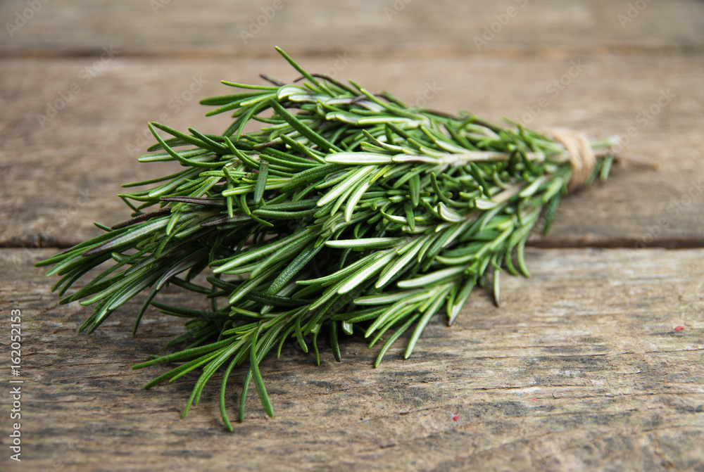 Fototapety, obrazy: Rosemary bound on a wooden board