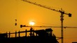 Silhouette Crane Working In Construction Site 4K Time Lapse