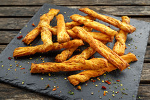 Cheese Twist, Sticks, Snack With Herbs On Stone Board