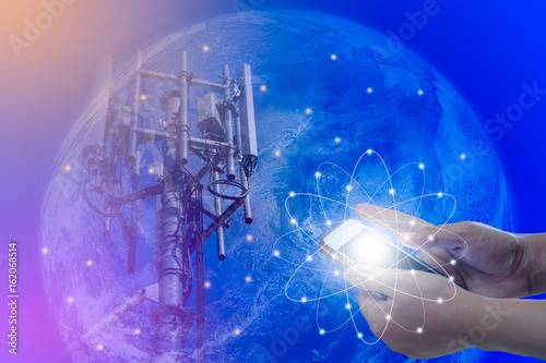 Deurstickers Nasa The concept of world communications, Smartphone in woman hand and Telecommunications tower on blue earth background, Elements of this image furnished by NASA