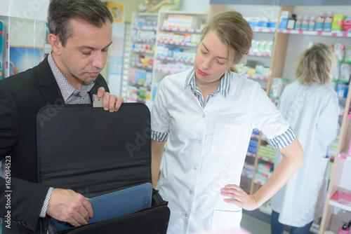 Fototapety, obrazy: positive female pharmacist counseling customer