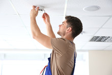 Young Electrician Installing S...