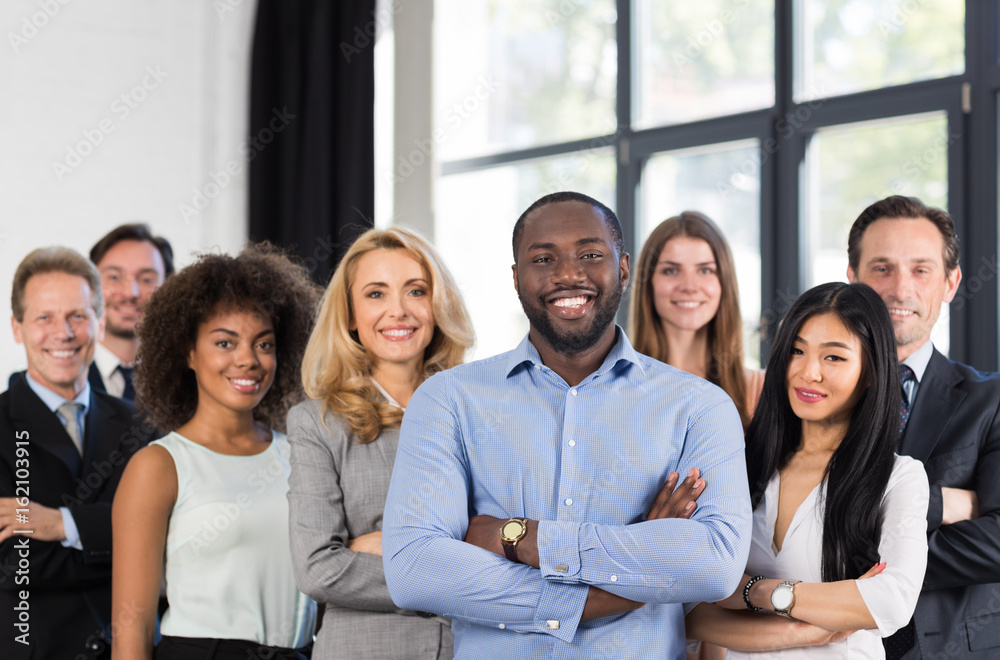 Fototapeta African American Businessman Boss With Group Of Business People In Creative Office, Successful Mix Race Man Leading Businesspeople Team Stand Folded Hands, Professional Staff Happy Smiling