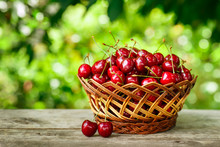 Cherries In Basket On Table In...