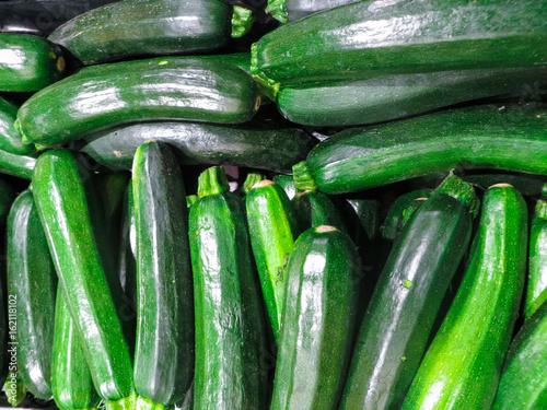 Fresh green zucchini in a box in the bazaar.