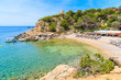 View of beautiful Cala Carbo bay with emerald green sea water, Ibiza island, Spain