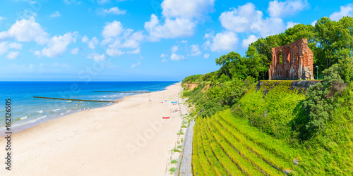 Panoramic view of ruins of old church in Trzesacz village on Baltic Sea beach, Poland