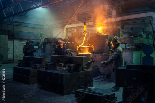 Valokuva  Metallurgical plant, hot metal casting and steelworkers