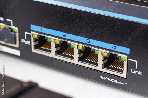 Photo Ethernet switch ports with PoE function closeup