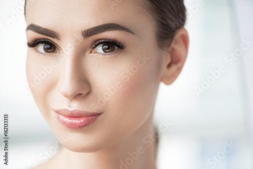 Photographie  Joyful beautiful girl with perfect facial cosmetics