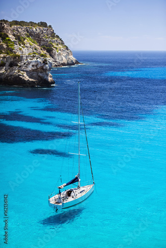 Beautiful bay with sailing yacht in Mediterranean sea. Travel and active lifestyle concept