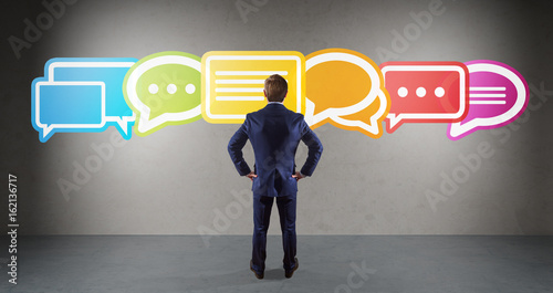 Photo  Businessman using social network interface on a wall 3D rendering