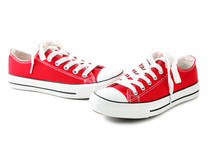 Pair Of Red Sneakers Isolated On A White