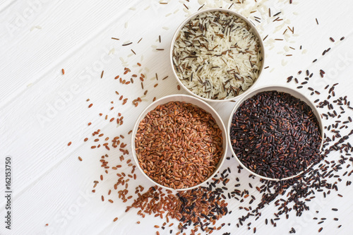 Canvas Prints Spices Set of variety of gourmet rice in bowls. Top view with copy space