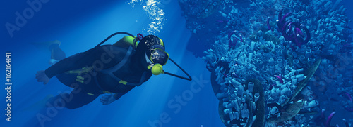 Silhouette of young man scuba diver Wallpaper Mural
