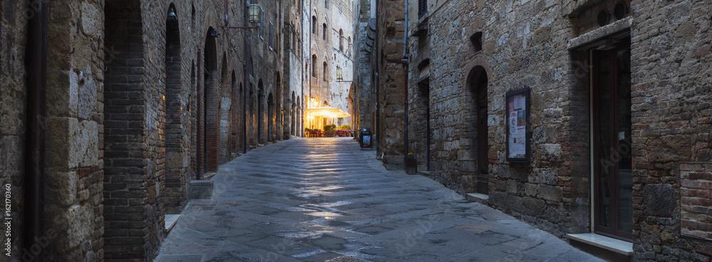 Fototapeta last night lights on the street in Tuscany city in Italy
