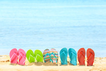 Colorful Flip-flops On Sand At Sea Shore. Vacation Concept