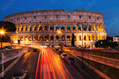Poster  Colosseum in Rome at night. Italy, Europe