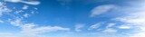 Fototapeta Na sufit - Panorama of blue sky background with white clouds on a sunny day