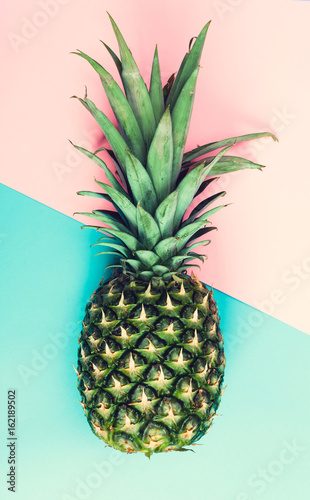 Fototapety, obrazy: Whole pineapple on a split dutone background