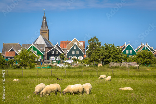Poster Monument View of Traditional dutch Village with colorful wooden houses