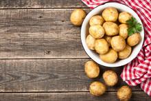 Raw Potato On Wooden Table