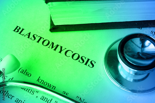 Page with diagnosis blastomycosis on a table. Canvas Print