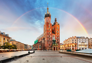 Fototapeta na wymiar St. Mary's basilica in main square of Krakow with rainbow