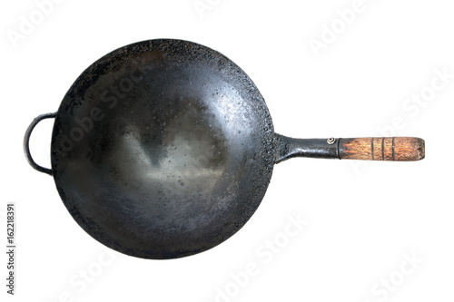 Old dirty frying-pan on white background