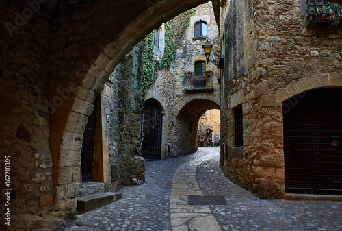 Doorgang of Carrer Major street in the medieval historic downtown of Pals. Bajo Ampurdan, Girona, Catalonia, Spain.