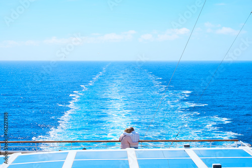 A couple on ship in the sea
