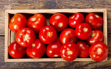 fresh tomatoes in a box
