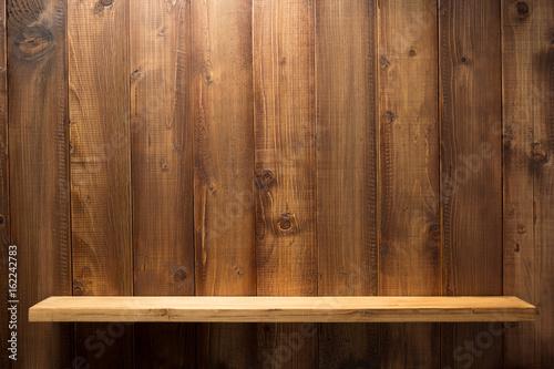 Photo wooden shelf at background