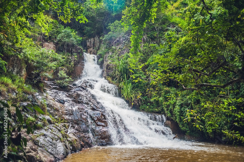 Leinwand Poster  Beautiful cascading Datanla waterfall In the mountain town Dalat, Vietnam