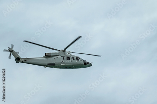 Tuinposter Helicopter Military navy helicopter in the sky