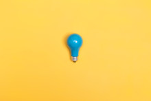 Blue Painted Light Bulb On A Vibrant Background