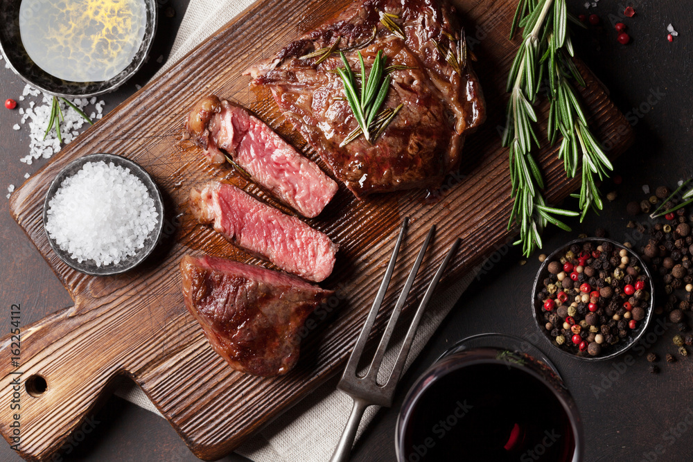 Fototapety, obrazy: Grilled ribeye beef steak with red wine, herbs and spices