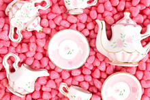 Small Tea Set In Pink. Miniature Ceramic Tea Cups And Tea Pots. Concept Of Love And Valentine's Day