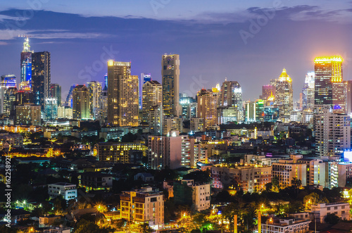 a view over the big asian city of Bangkok , Thailand at nighttime when the tall Wallpaper Mural