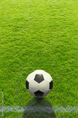 Obraz Hintergrund ein Fußball liegt vor einer Linie auf dem Rasen - Background a soccer ball lies in front of a line on the grass - fototapety do salonu