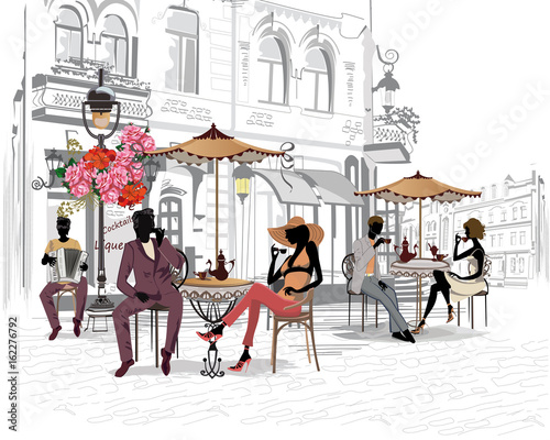 Fototapety, obrazy: Fashion people in the street cafe. Street cafe with flowers in the old city.