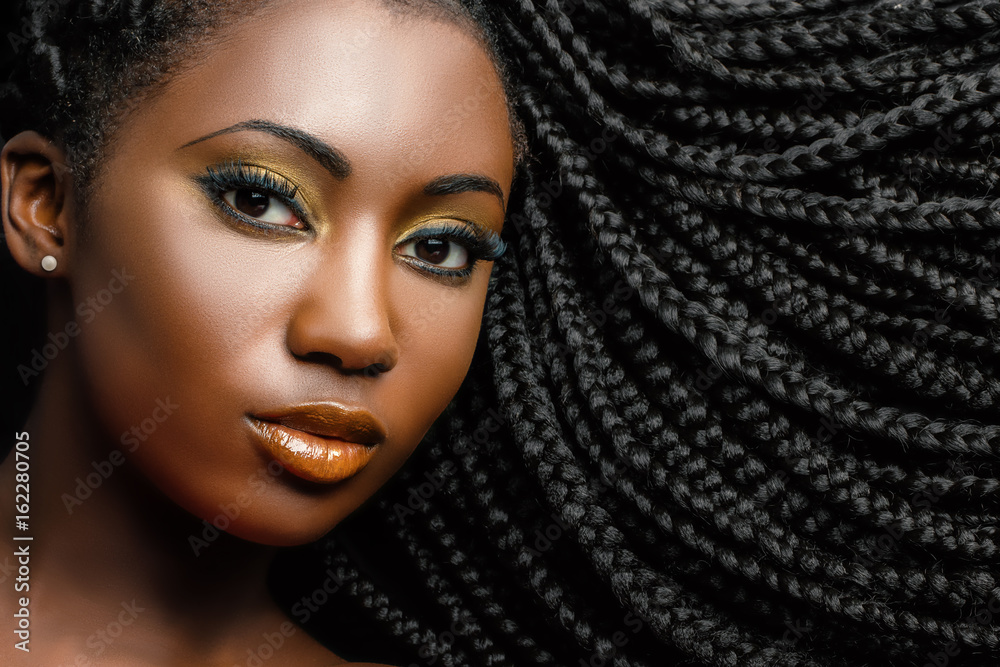 Fototapety, obrazy: African cosmetic portrait of woman showing braided hairstyle.