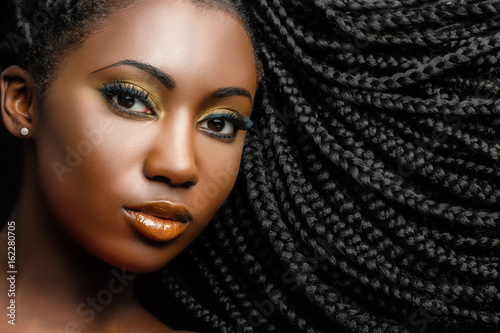 African cosmetic portrait of woman showing braided hairstyle. Canvas Print