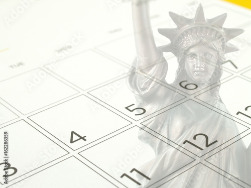 close up white desk calendar page with days and dates in