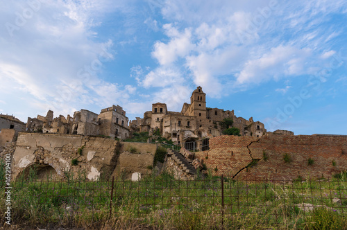 Fotografie, Obraz  Craco (Italy) - The evocative ruins and landscapes of the ghost town scattered among the badlands hills of the Basilicata region, beside Matera, destroyed by a landslide and abandoned