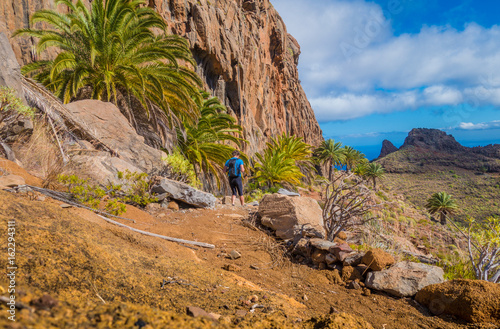 Tuinposter Canarische Eilanden Hiker on a trail in the Canary Islands, Spain