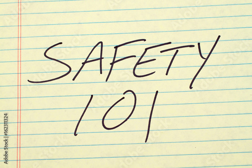 "The words ""Safety 101"" on a yellow legal pad плакат"