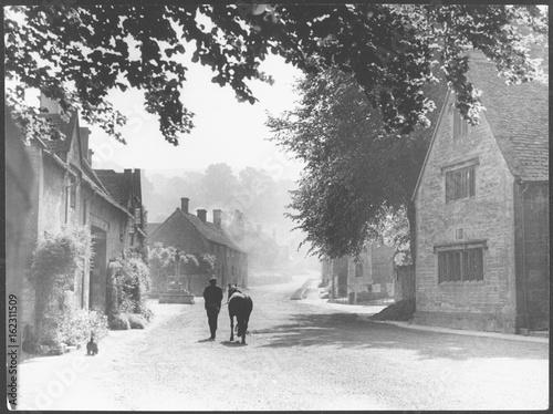 Cotswolds Village Scene. Date: 1940s Canvas Print