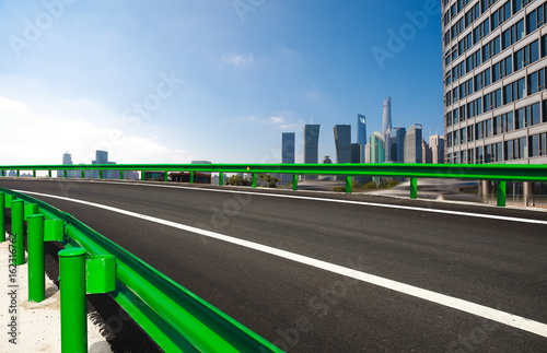 Empty road surface floor with city landmark buildings Poster
